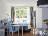 Foto Smartes Apartment mit Balkon & Kitchenette am...
